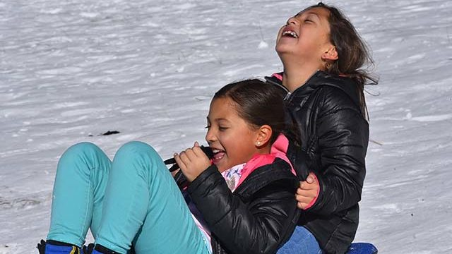 Alexa and Mikaela, twin 9-year-olds from Fallbrook enjoy the snow in the Lagunas.