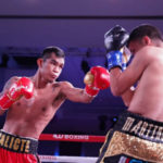 ston Palicte of the Philippines throws a left hook at Jose Martinez of Puerto Rico