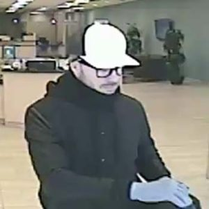 Surveillance photos of bank robber.