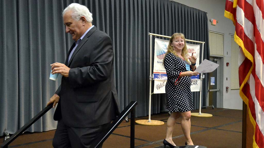 La Mesa-Foothills Democratic Club President Tina Rynberg looks back at Ted Leitner after his remarks.