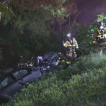 First responders with the two wrecked vehicles