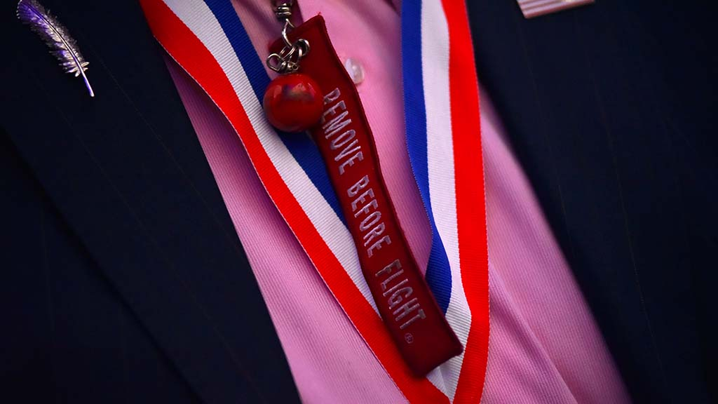 """Buzz Aldrin sported a ribbon """"Remove before flight"""" that dated to the Apollo Lunar Lander."""