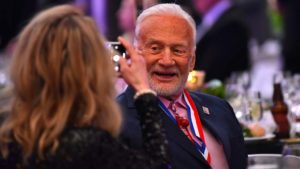 Buzz Aldrin smiled for his partner's camera before the Apollo 9 anniversary program at the San Diego Air & Space Museum.