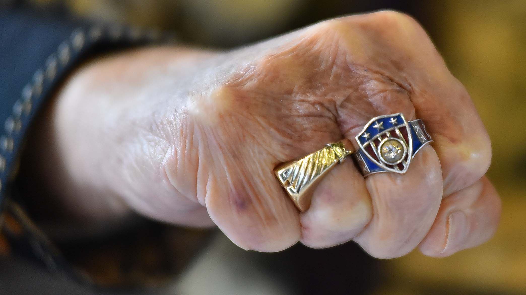 Artist Allen Bellman shows off his custom-made ring with a Captain America shield with a diamond in the middle.
