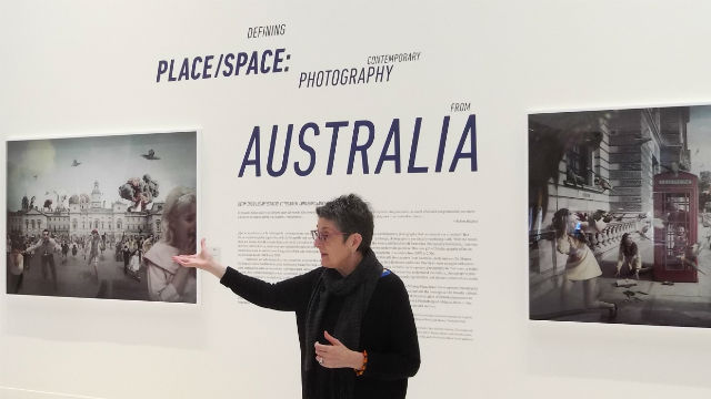Deborah Klochko explains photos in the exhibition