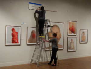 Museum personnel setting up the exhibition