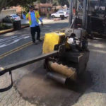 City of San Diego crew fills a pothole
