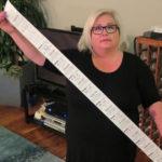 Carol Dahmen with a 4-foot-long receipt