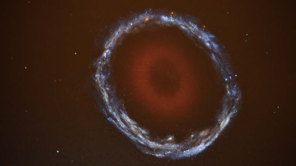 An artist's rendition of Burçin's Galaxy shows the older red inner ring and younger bluish outer ring.