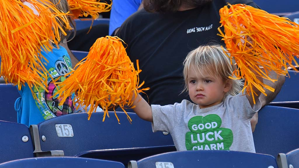 Waving Fleet colors, a young fan stays determined for San Diego success.