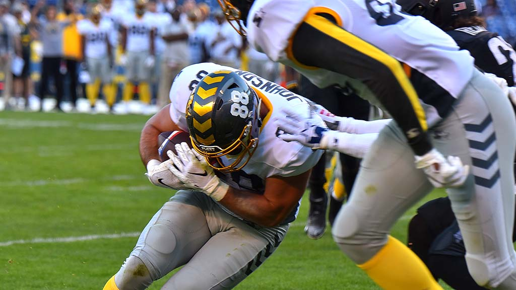 Fleet tight end Ben Johnson pushes into end zone for a touchdown. Photo by Chris Stone
