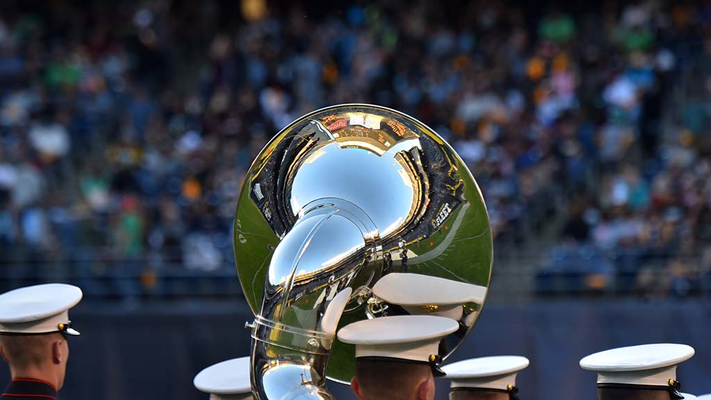 SDCCU Stadium is reflected in horn of the 3rd Marine Aircraft Wing band at halftime of Fleet-Iron game.