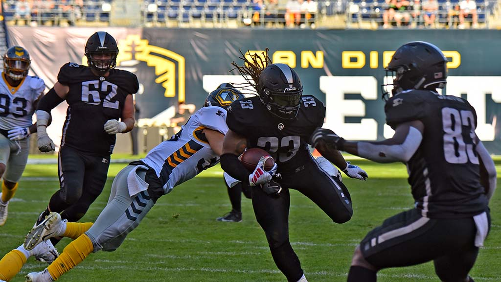 Trent Richardson, who played college ball for Alabama, tries to elude the Fleet.