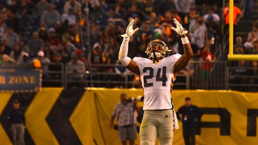 Fleet defensive back Kameron Kelly signals to heaven after good play.