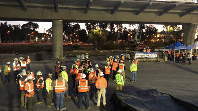 Construction crews gather at the Voigt Drive Trolley  station