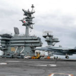 F-18 Hornet lands on the USS Abraham Lincoln