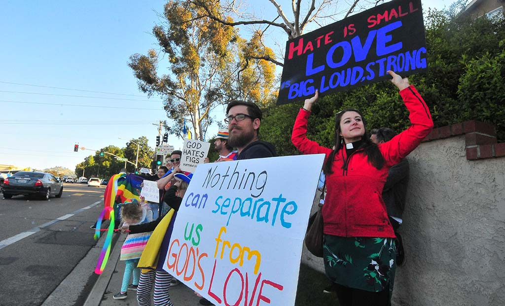 About 150 people gathered across the street from Monte Vista High School to oppose the views of Westboro Baptist Church members.