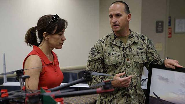 "Lt. Cmdr. Jim Celani, shown briefing Under Secretary of the Navy Janine A. Davidson, was ""a truly innocent, vulnerable victim,"" trial is told."
