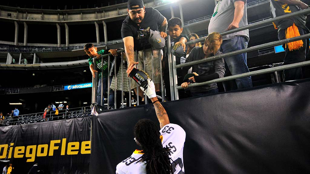 Fleet defensive back Ron Brooks hands back an autographed item after narrow loss to the Iron.