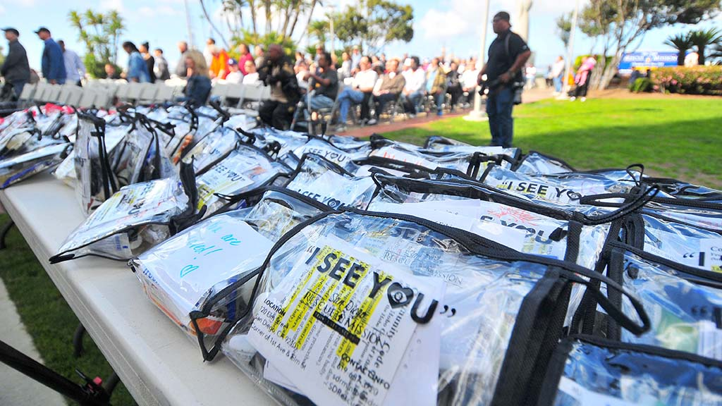 "As part of the San Diego Rescue Mission's ""I See You"" campaign, volunteers give homeless people a kit that contains hygiene items, snack bars and information about the Mission's program."