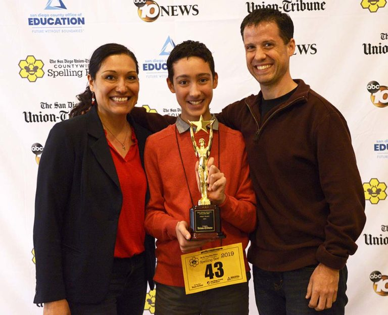 Elliott Husseman, winner of 50th county spelling bee, with his parents.