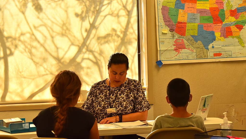 Laura Arroyo of Jewish Family Service meets with family members seeking asylum.