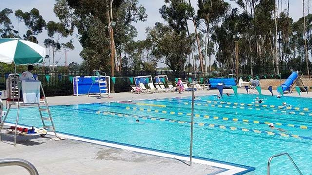 Lifeguard keeps eye on swimmers at Tierrasanta pool.