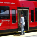 Trolley rider inspects new car