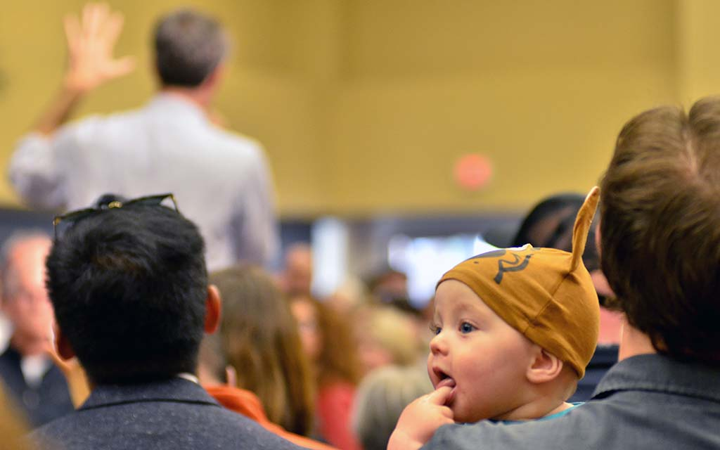 Documentary filmmaker Kevin Tostado brought his 6-month-old son Sam (in Scooby-Doo hat) to Beto O'Rourke event. Photo by Ken Stone
