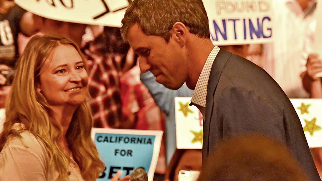 """Beto O'Rourke takes the stage amid admiring eyes of campaign staffer who introduced him as """"humble, down-to-earth and real."""" Photo by Chris Stone"""
