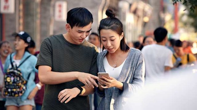 Chinese citizens using a smartphone