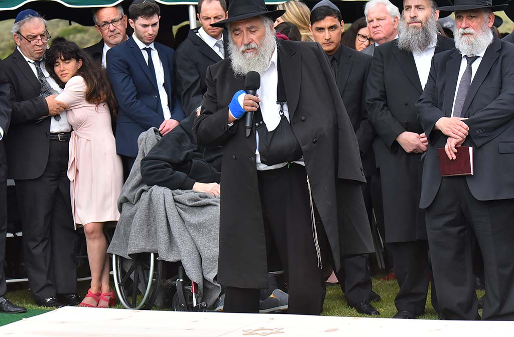 Chabad of Poway Rabbi Yisroel Goldstein speaksLori Kaye's grave during the burial at El Camino Memorial Cemetery.