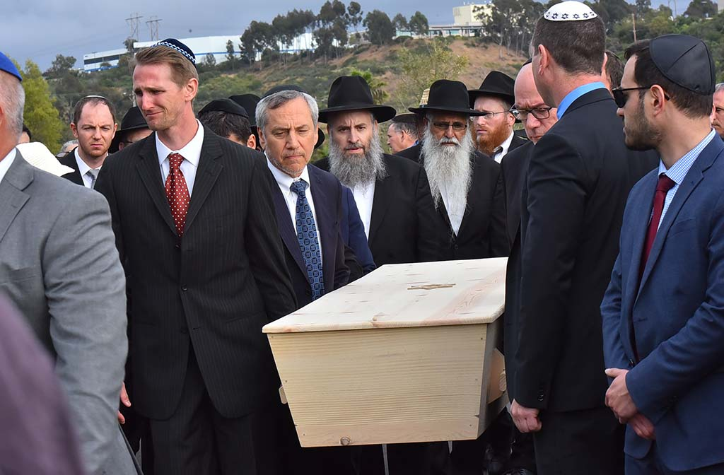 Pall bearers carry the casket of Lori Kaye at El Camino Memorial Cemetery, two days after she was killed by a gunman.