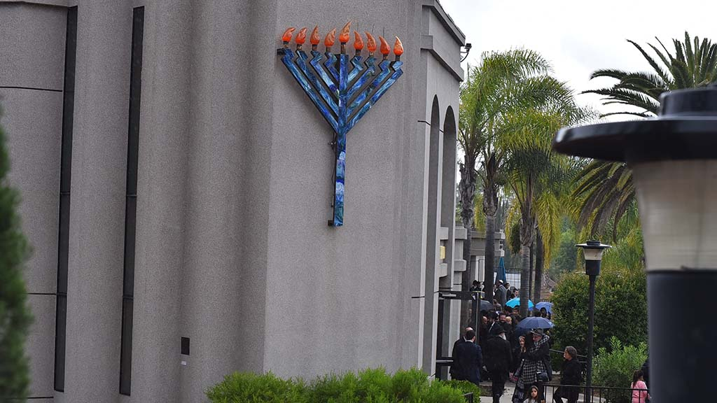 Members of the Chabad of Poway congregation gathered inside and outside the synagogue to pay respects to Lori Kaye who was killed there Saturday.