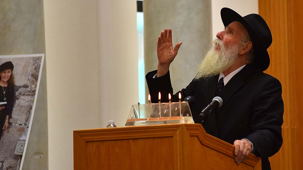 A rabbi looks toward the heavens as she speaks of the good works of Lori Kaye.