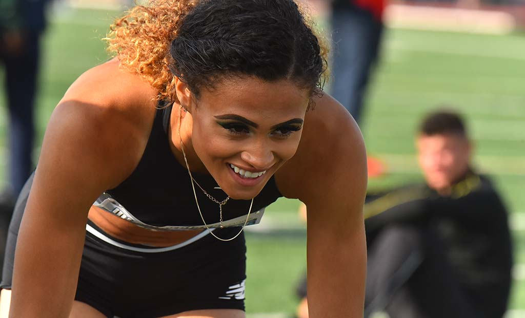 New Balance's hurdler Sydney McLaughlin relaxes after her team won a 4 X 400 relay.