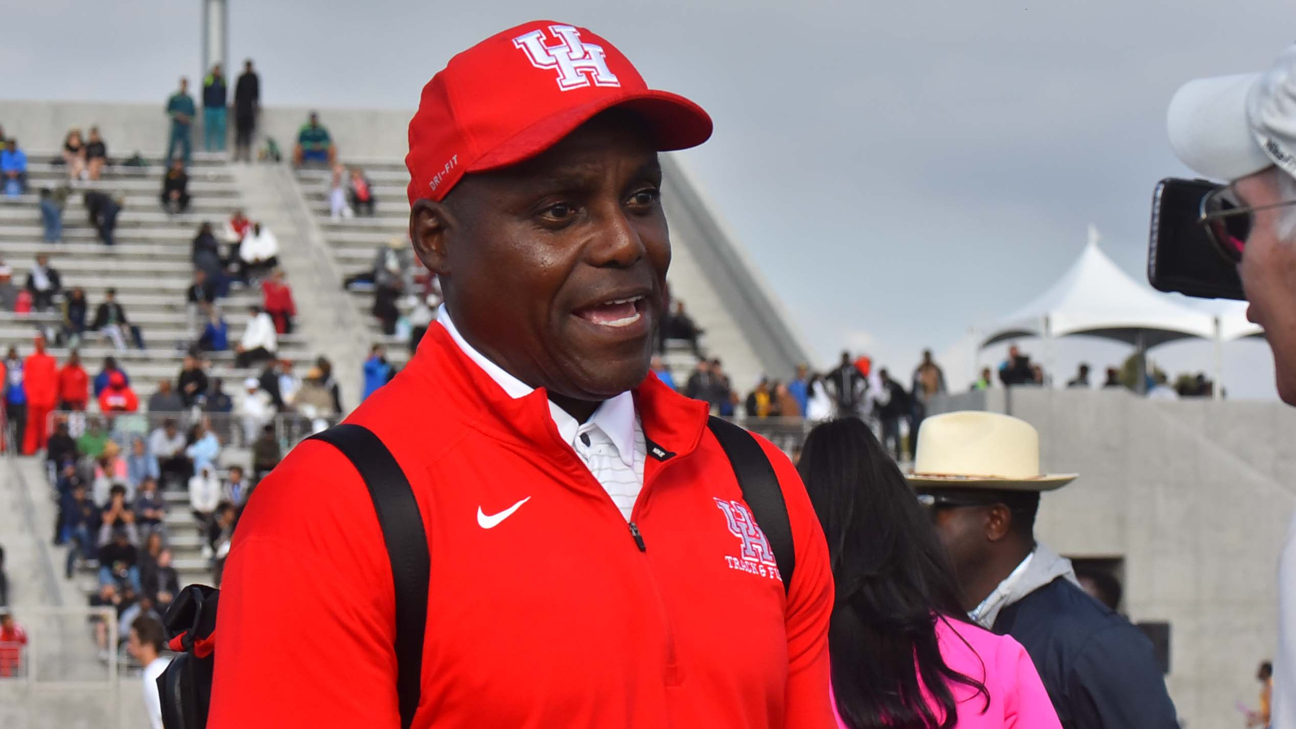 Nine-time Olympic gold medalist Carl Lewis spoke to a reporter at the Mt. Sac Relays in Torrance, where he coached a team from the University of Houston.
