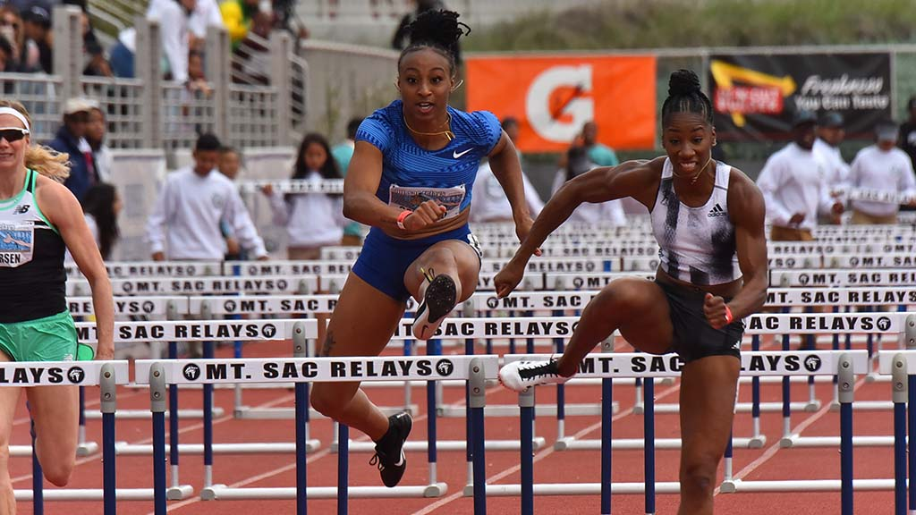 Keni Harrison (right) edges past Jasmine Camacho-Quinn in the 100m hurdles at Mt. Sac Relays.