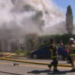 Smoke billows from burning apartment buildings