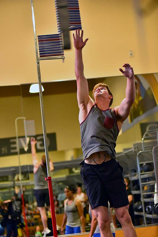 Kyle Destackelberg does the vertical jump, one of three skills tested at the 24 Hour Fitness center in Kearney Mesa.