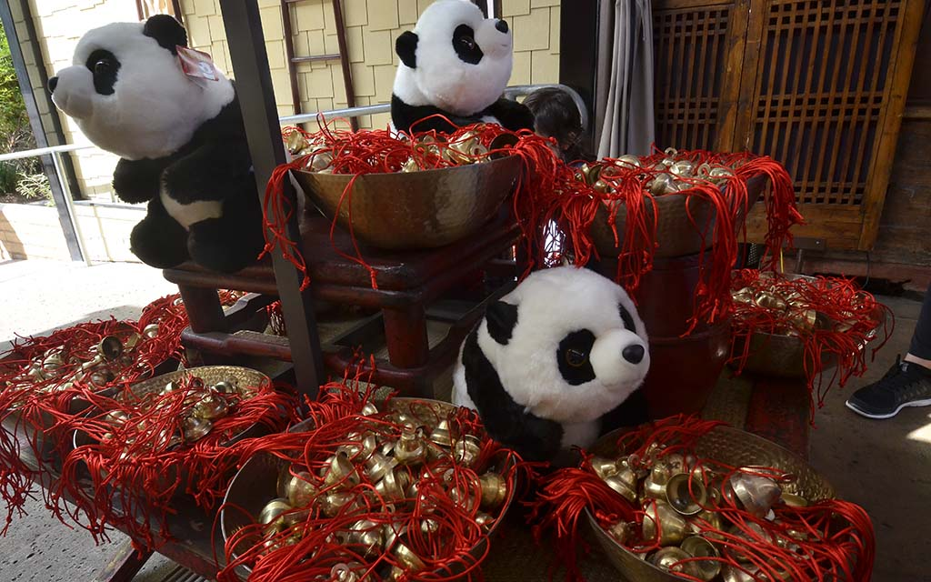Stuffed pandas and bells for the Giant Panda Friendship Wall are sold at the Panda Shop at the San Diego Zoo.