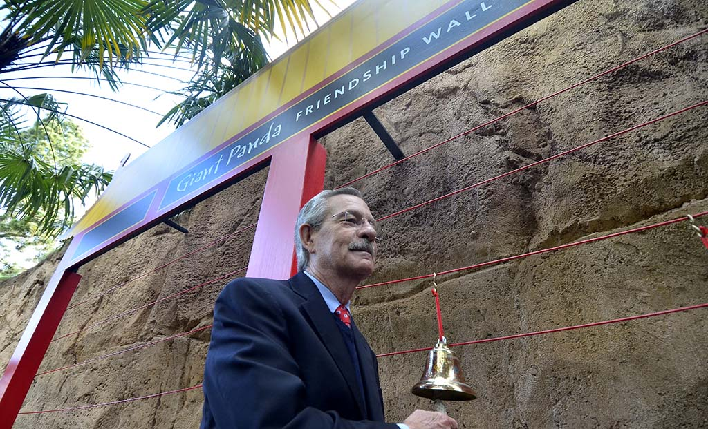 Douglas Myers, President/CEO, San Diego Zoo Global, rings a bell at the Giant Panda Friendship Wall.