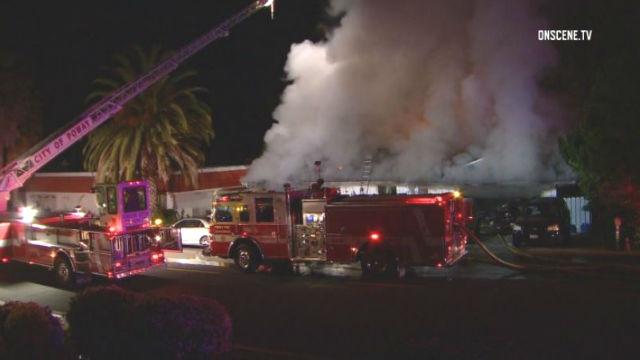 Fire trucks outside the burning home