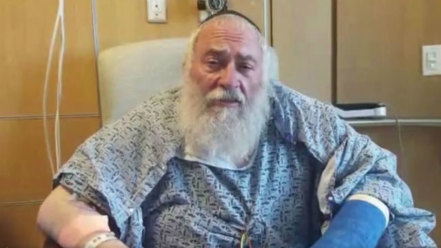 Rabbi Yisroel Goldstein in his hospital bed