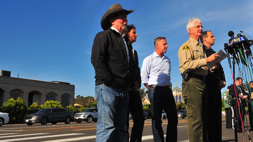 Poway Mayor Steve Vaus, an FBI agent, Rep. Scott Peters, Sheriff Bill Gore and San Diego Police Chief David Nisleit appear for a press conference.