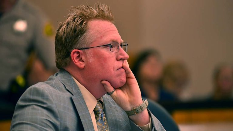 Cory Briggs listens as opposing lawyer tells why San Diego County feared the occupation of the Julian fire station by its volunteer firefighters and supporters.