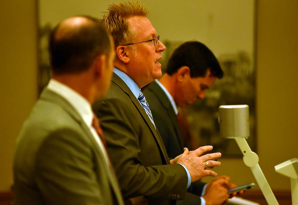 """Cory Briggs reveals that $374,000 in the bank accounts of """"dissolved"""" JCFPD has been moved to a trust account outside county reach. Craig Sherman listens at left."""
