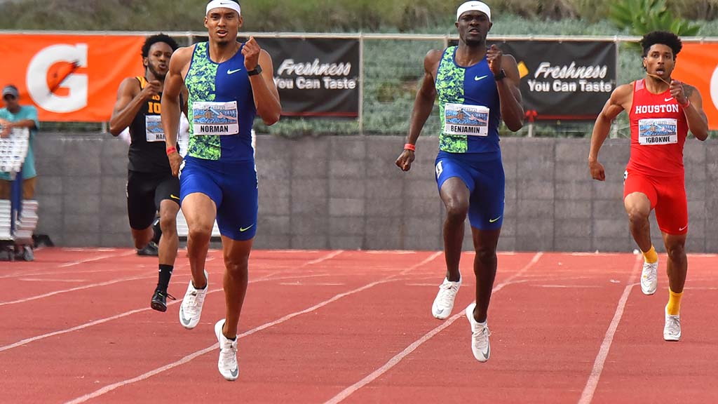 Michael Norman (left) and Rain Benjamin mirror each other's form in the final stretch of the 400-meter dash at the 61st Mt. SAC Relays.