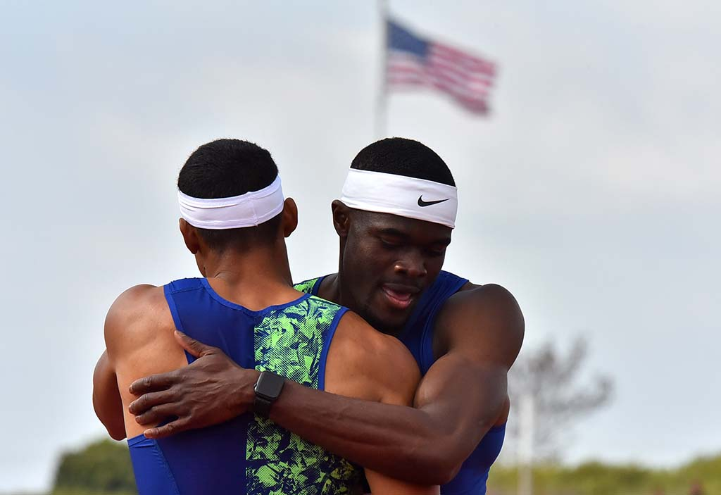 Michael Norman (left) and Nike teammate Rai Benjamin embrace