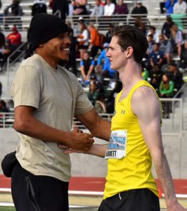Roderick Townsend-Roberts congratulates event winner Django Lovett in the men's invitational high jump at Mt. SAC Relays.